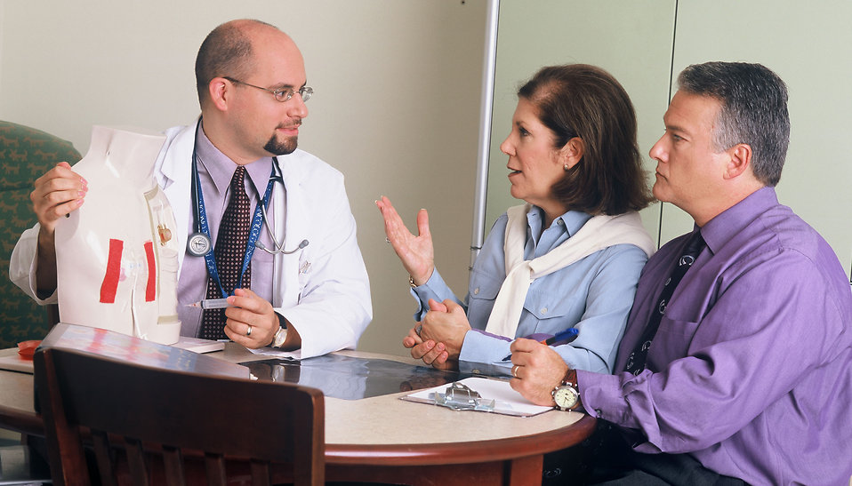Doctor talking to patients